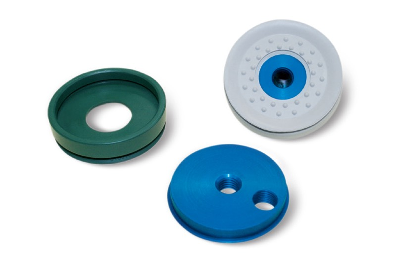 Round flat vacuum cups with supports